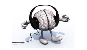 brain with headphones role of an audiologist blog image